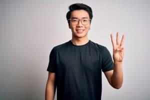 man showing three fingers